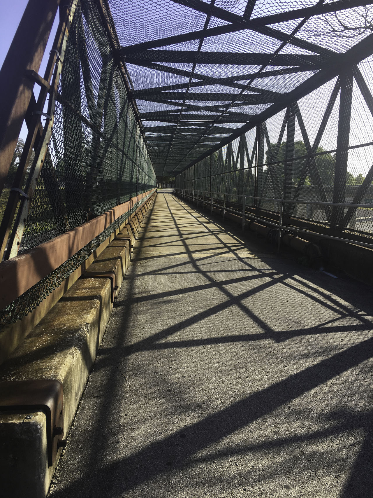 Looking down the rail Architecture Bridge - Man Made Structure Built Structure City Connection Day Elevated Walkway Footbridge Lines No People Outdoors Railing Shadow Sky Staircase The Way Forward