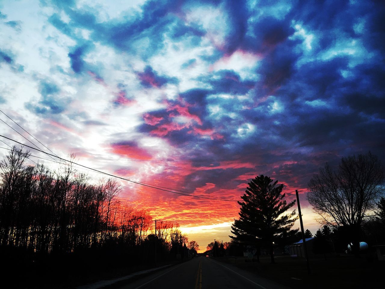 tree, cloud - sky, sky, silhouette, sunset, scenics, nature, dramatic sky, beauty in nature, tranquil scene, road, tranquility, no people, outdoors, bare tree, transportation, landscape, day