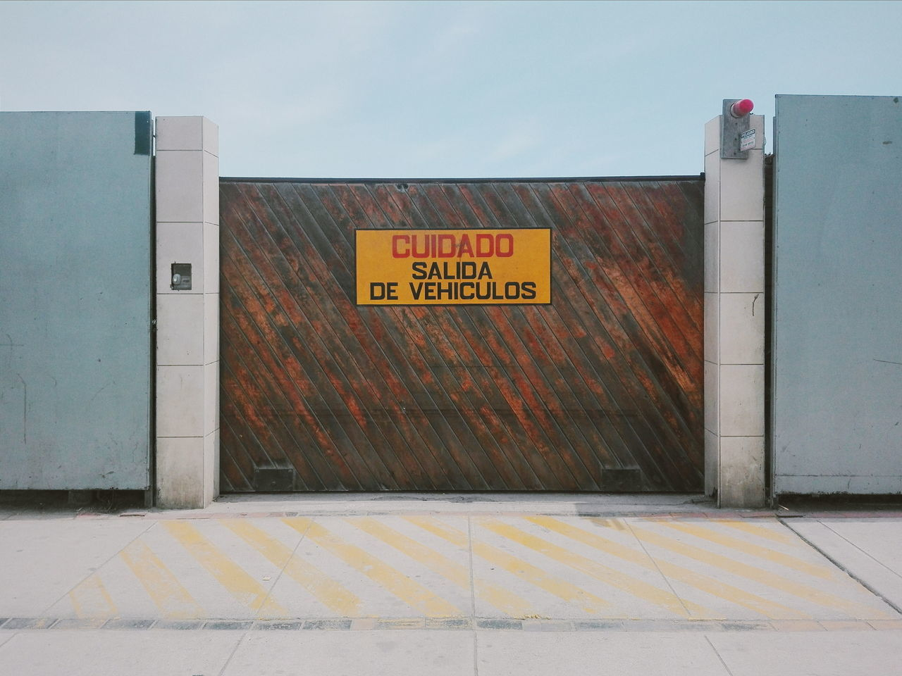 text, entrance, communication, built structure, architecture, door, yellow, no people, day, outdoors, building exterior