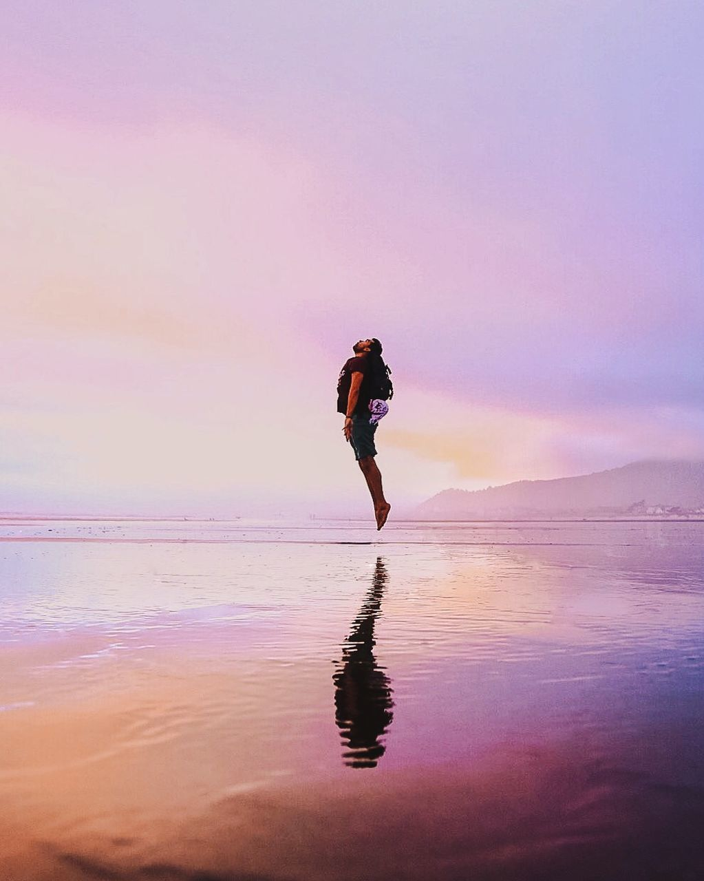 water, sunset, reflection, full length, one person, nature, sea, beauty in nature, sky, real people, tranquility, leisure activity, outdoors, beach, lifestyles, scenics, standing, women, day, young adult, people