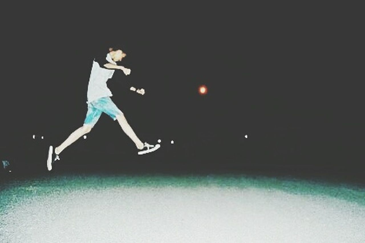 jumping, mid-air, full length, motion, sport, night, one man only, one person, only men, adult, skill, adults only, sports clothing, people, sportsman, side view, one young man only, athlete, playing, competition, outdoors, young adult