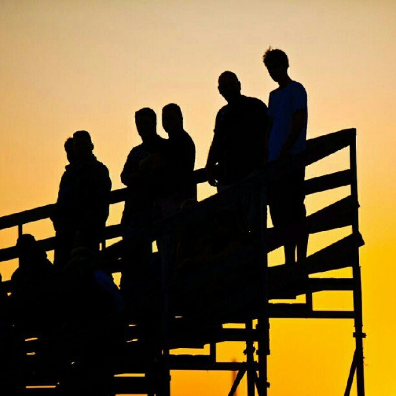 silhouette, sunset, outdoors, people, standing, men, adult, group of people, prison, adults only, nature, performance group, sky, day, only men