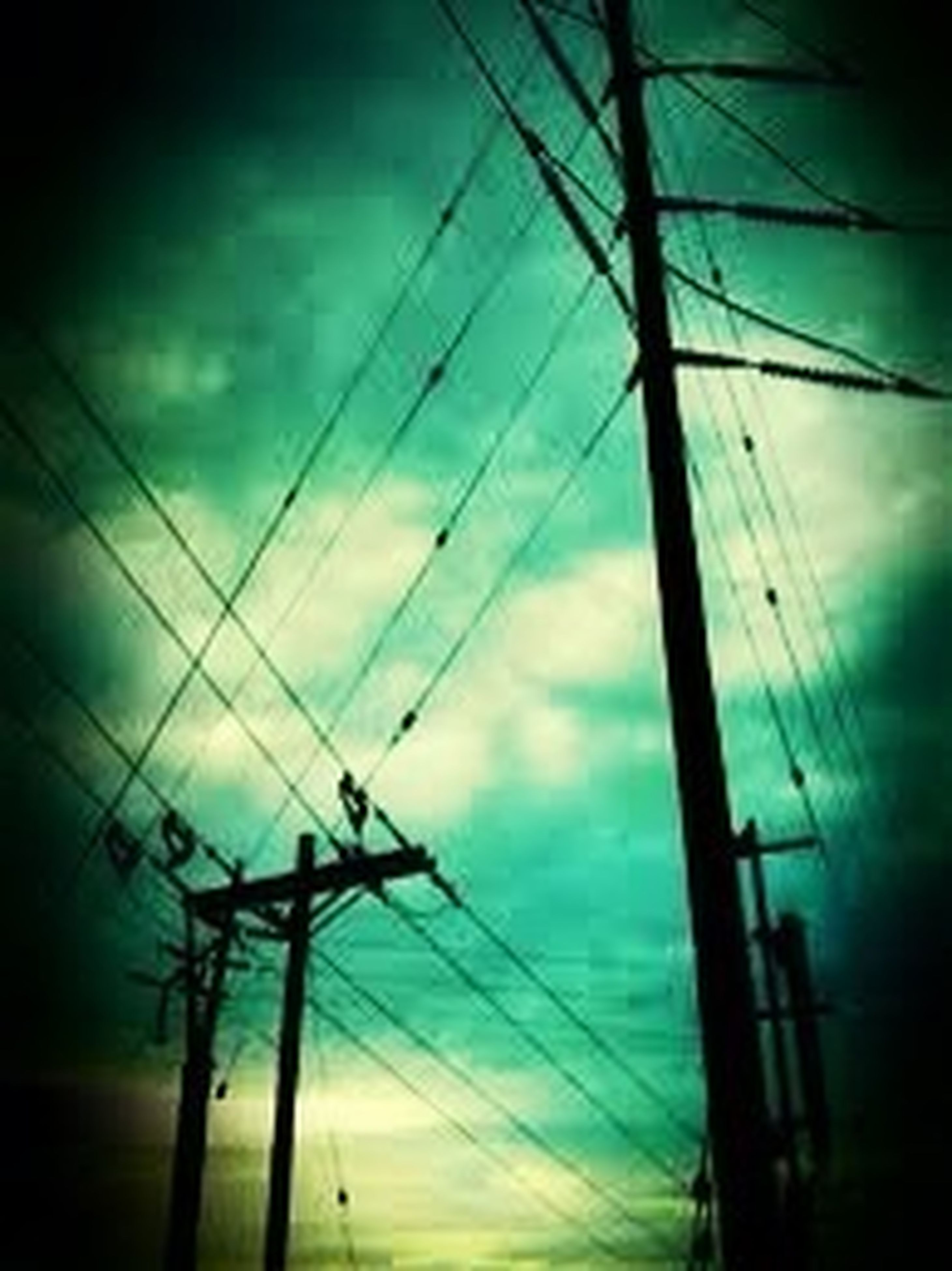 low angle view, power line, electricity, power supply, sky, electricity pylon, silhouette, cable, connection, technology, cloud - sky, fuel and power generation, cloudy, cloud, dusk, power cable, no people, outdoors, day, nature