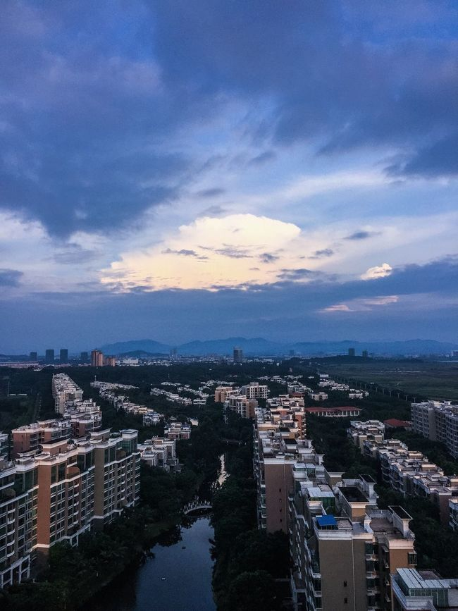 Architecture Built Structure Building Exterior City Sky High Angle View Cityscape Water Cloud - Sky Crowded Cloud River Blue Residential District Outdoors City Life Day Wide No People Development China Zhuhai