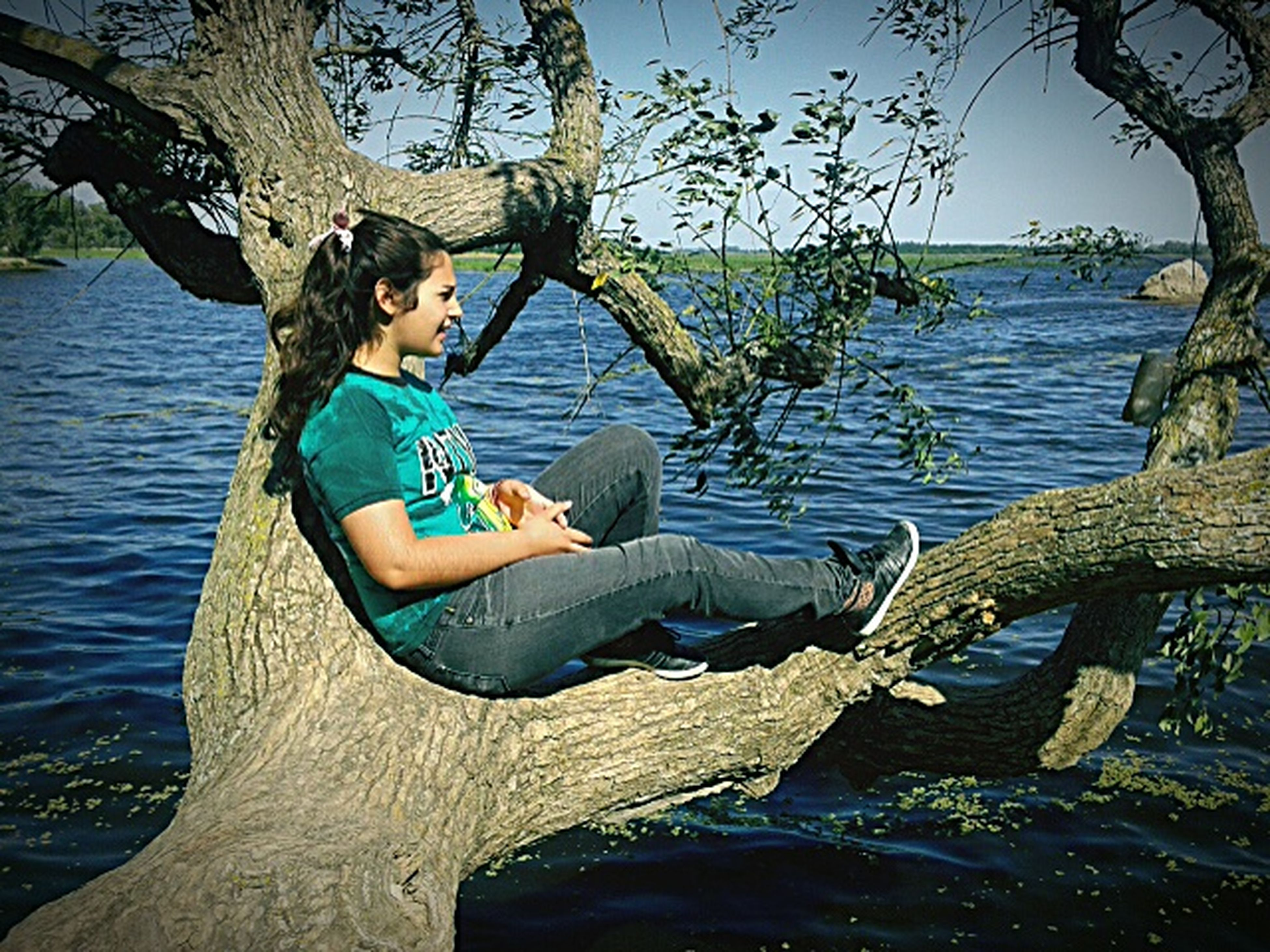water, lifestyles, leisure activity, young adult, full length, casual clothing, tree, sitting, lake, young women, standing, nautical vessel, nature, tranquility, person, relaxation, vacations, day