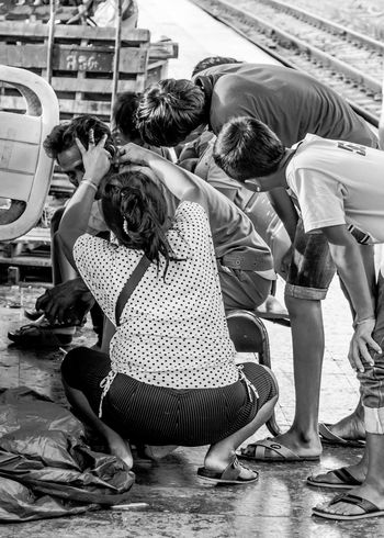 Group of boys watching at ear Black & White Black And White Care Ear Interesting Leisure Activity Life Lifestyles Man People Railway Slow Life Thailand The Portraitist - 2016 EyeEm Awards Train Station Treatment Vintage Watching Woman The Street Photographer - 2016 EyeEm Awards My Commute My Commute-2016 EyeEm Photography Awards