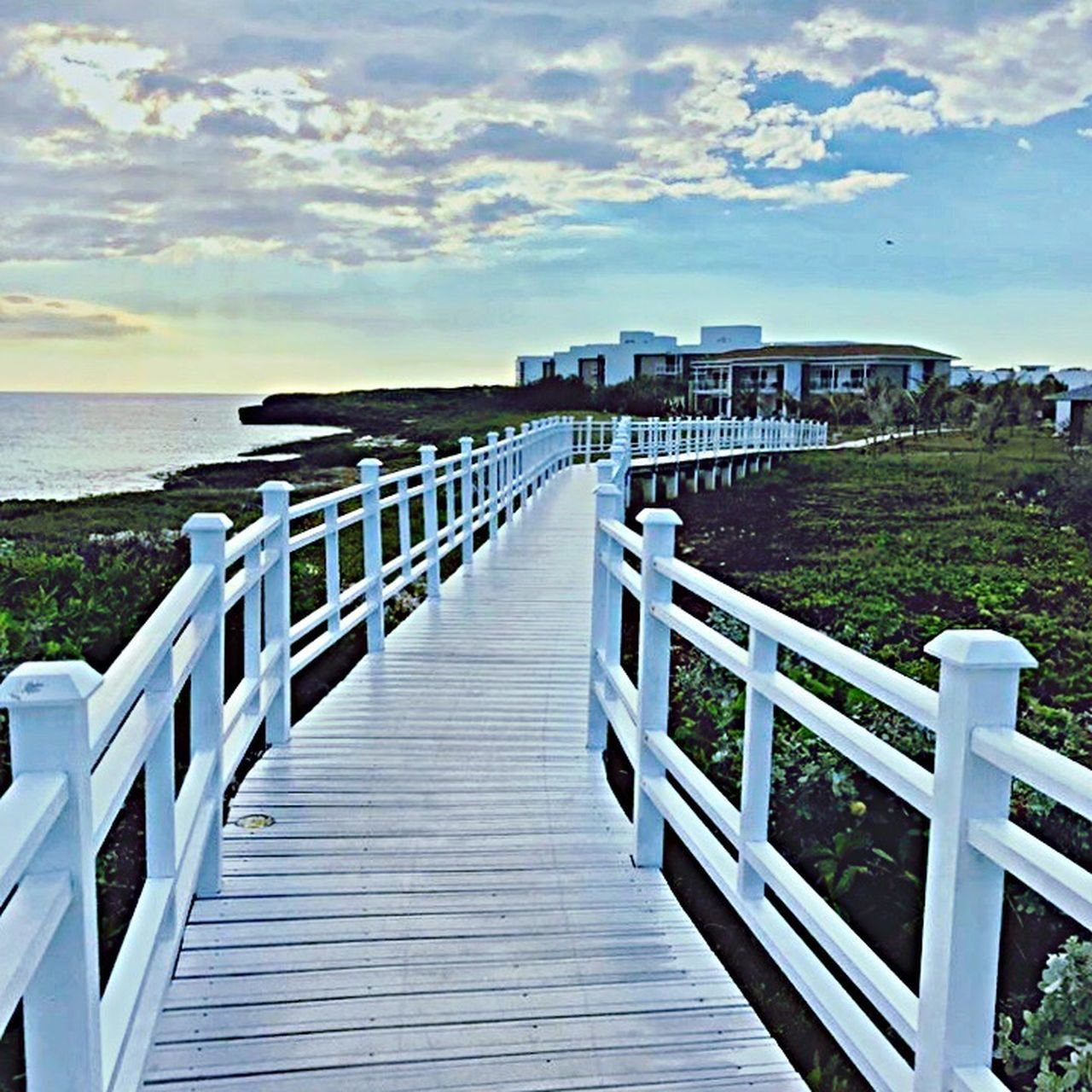 sea, railing, sky, cloud - sky, horizon over water, water, outdoors, built structure, nature, day, scenics, tranquil scene, tranquility, no people, beach, beauty in nature, architecture