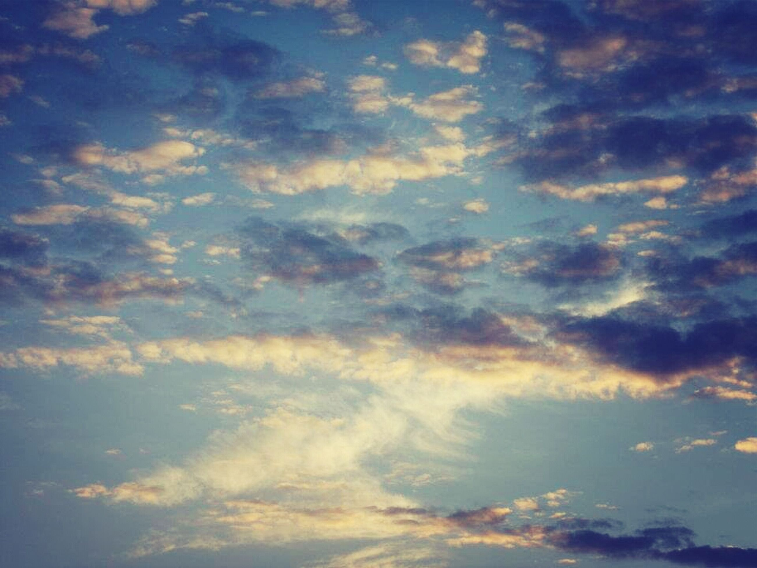 sky, cloud - sky, low angle view, beauty in nature, sky only, scenics, tranquility, cloudy, tranquil scene, cloudscape, nature, cloud, backgrounds, blue, idyllic, sunset, full frame, majestic, outdoors, dramatic sky