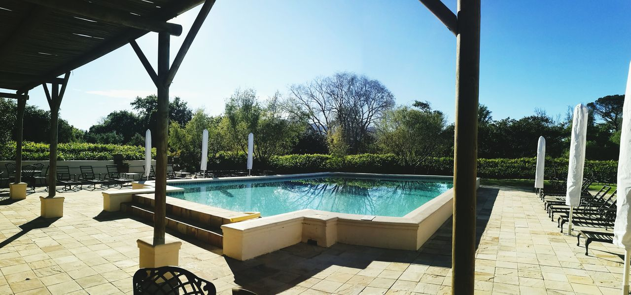 Breakfast at the poolside Tree Water Sunlight Clear Sky Tranquil Scene Outdoors Formal Garden Travel Destinations Man Made Object Universitylife Event Venue Events Springtime Rural Scene