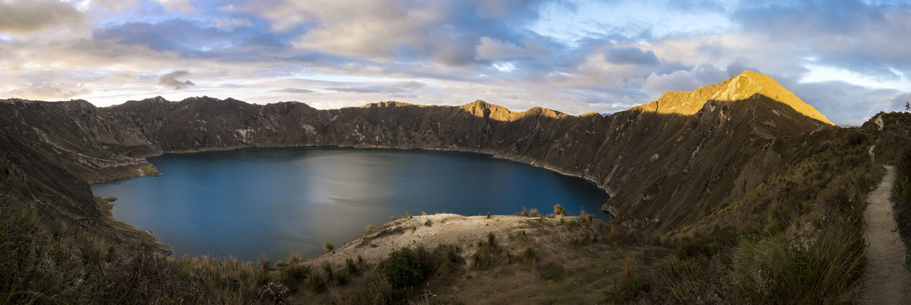 Sunset in the Quilotoa volcano crater Beauty In Nature Blue Cloud - Sky Ecuador Geology Lake Majestic Mountain Mountain Range Nature Non-urban Scene Outdoors Panoramic Physical Geography Quilotoa Laguna Remote Rocky Scenics Seascape Surrounding Tourism Tranquil Scene Tranquility Volcano Crater Water