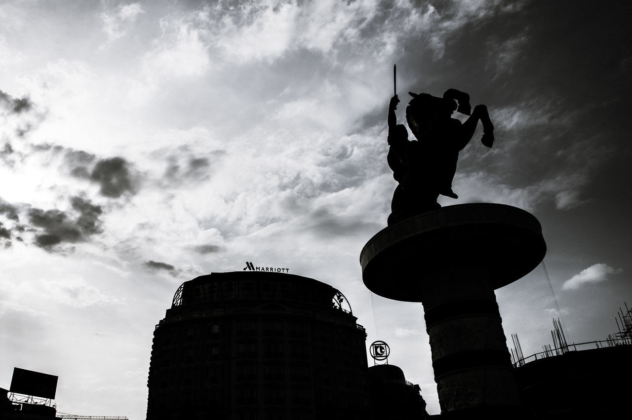 Sky is the limit Architecture Black And White Building Exterior Built Structure City Cloud - Sky Day Dramatic Sky EyeEm Best Shots EyeEm Streets Low Angle View No People Outdoors Sculpture Silhouette Skopje Skopje Centar Sky Sky And Clouds Statue Travel Destinations