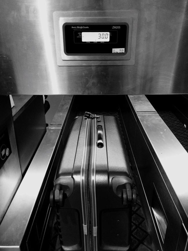 Just enough to meet the 30Kg check-in luggage weight limit! Luggage Check-in Luggage Airport Check-in Counter 30kg Digital Scale Monochrome Black And White