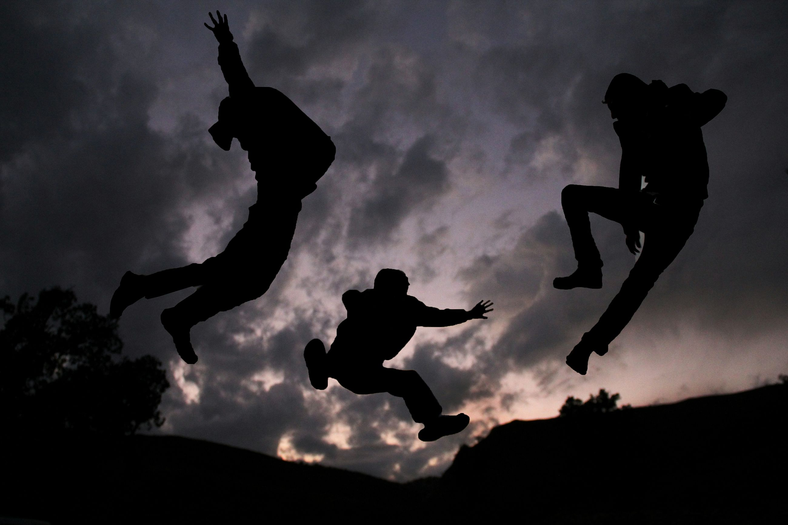 silhouette, sky, cloud - sky, low angle view, sunset, cloudy, mid-air, cloud, dusk, creativity, art, sculpture, statue, art and craft, human representation, jumping, animal representation, full length, outdoors