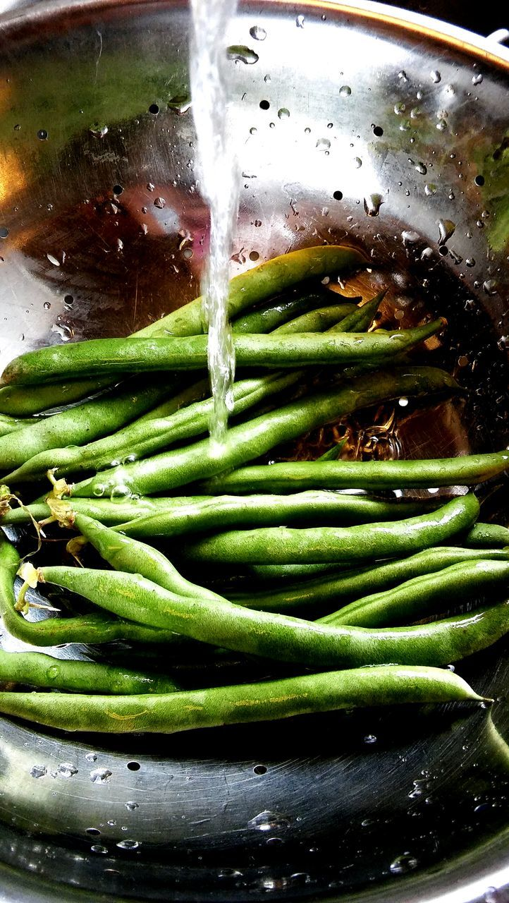 Water Poured On Green Bean In Metal Bowl