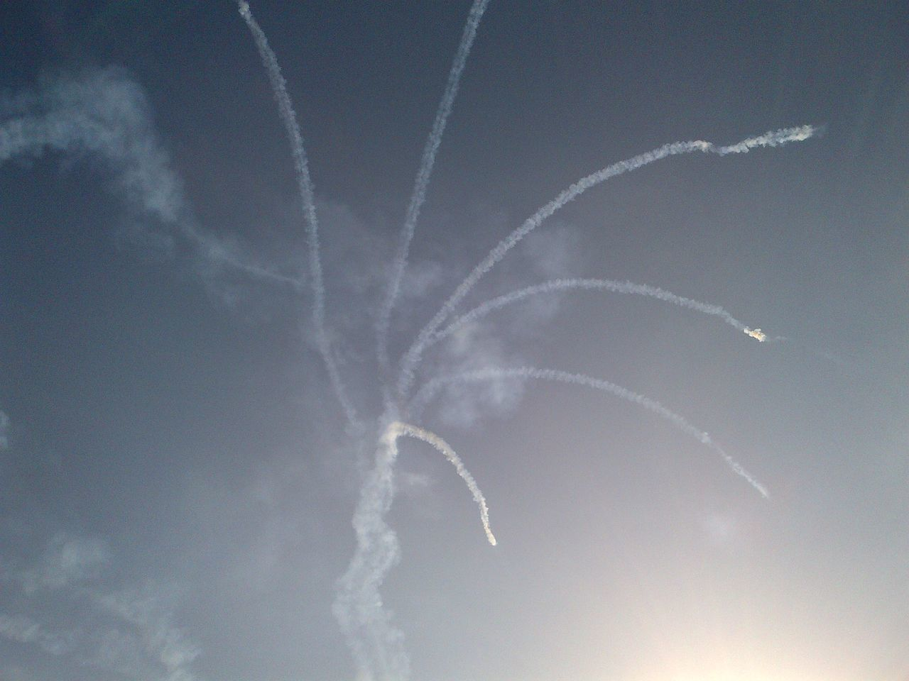 vapor trail, sky, low angle view, smoke - physical structure, airshow, no people, transportation, outdoors, blue, motion, day, nature, scenics, airplane, beauty in nature, contrail, clear sky