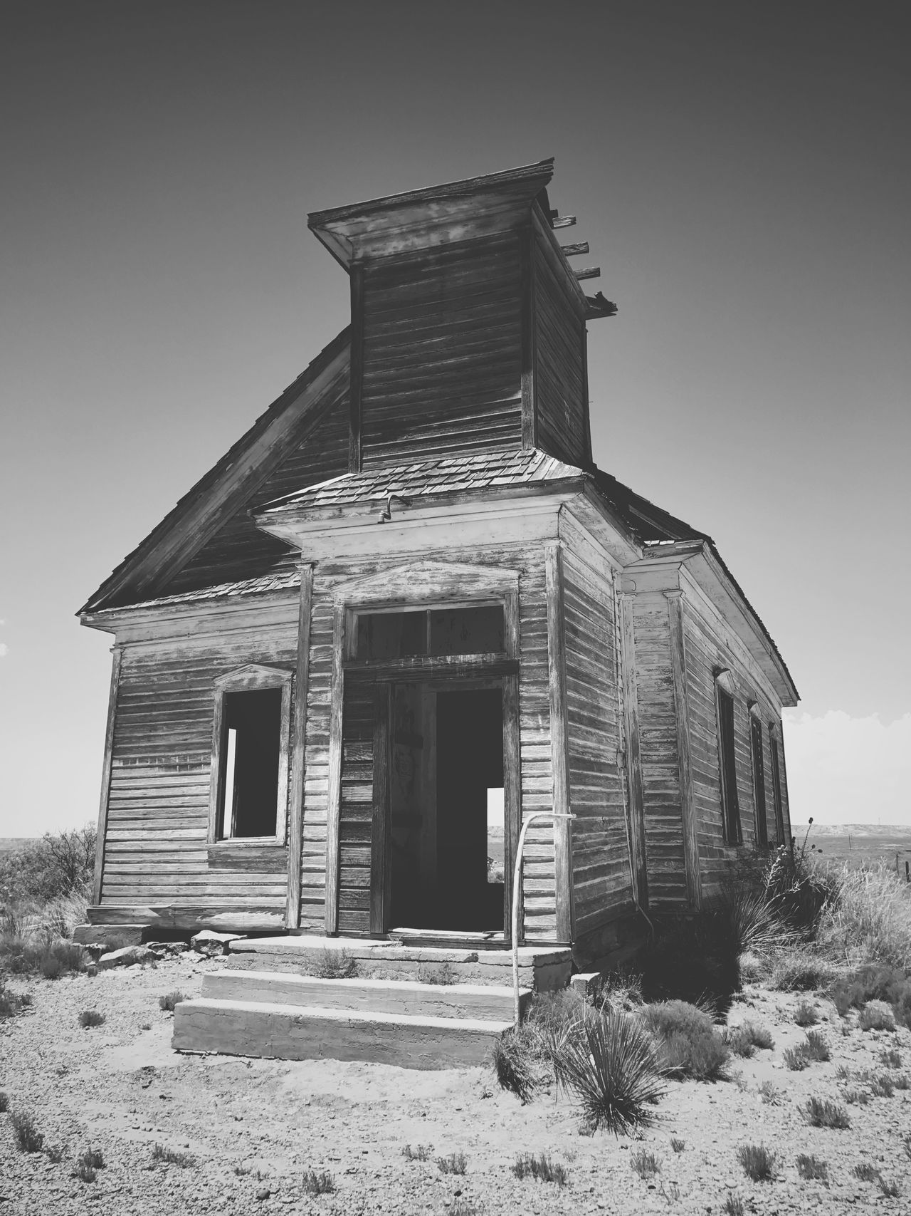 """""""God Has Left The Building"""" The long abandoned Taiban, New Mexico Presbyterian Church, built in 1908 stands alone...no longer with a soul. Architecture Building Exterior Abandoned Blackandwhite Photography Black & White Blackandwhite Newmexicophotography Ghost Town Abandoned Places New Mexico Church Architecture Abandoned Buildings"""