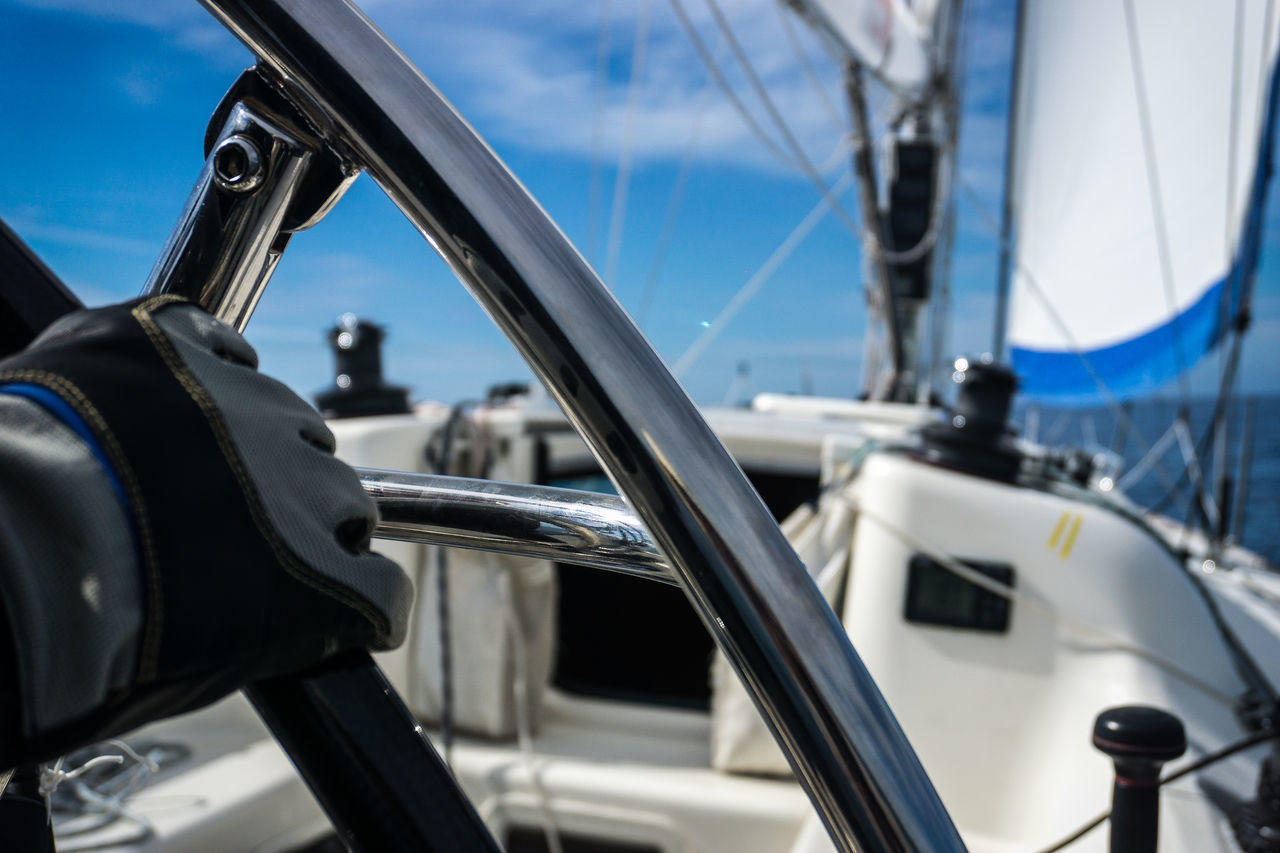 Steering the Rudder of Sport Sailing Yacht Adventure Boat Deck Captain Certainty Close-up Day Deck Exploring Fullahead Glove Nautical Vessel No People Outdoors Regatta Rudder Sailboat Sailing Sailing Ship Sea Seafaring Sky Transportation Wheel Yacht Yachting EyeEmNewHere