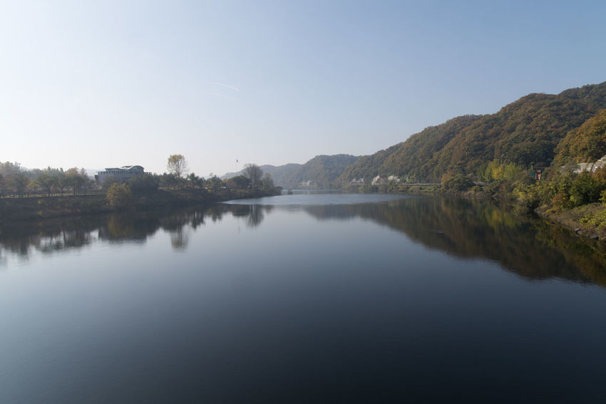 View of Daecheong Lake in Daejeon, Chungnam, South Korea Autumn Daecheong Dam Daecheong Lak Daecheongho Autumn Lake Beauty In Nature Clear Sky Day Lake Lake View Lake Views Mountain Nature No People Outdoors Reflection Scenics Sky Tranquil Scene Tranquility Tree Water Waterfront