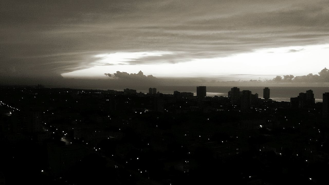 cityscape, architecture, skyscraper, sky, building exterior, city, silhouette, cloud - sky, no people, built structure, travel destinations, storm cloud, modern, outdoors, illuminated, nature, beauty in nature, day