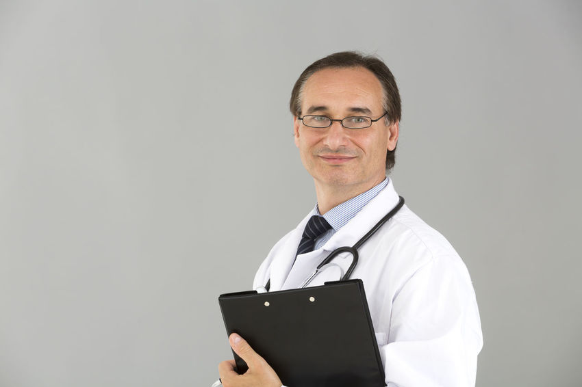 Clipboard Reassuring Stethoscope  Reassurance Doctor  Portrait Medical Real People Standing Occupation Person Holding Man With Glasses Medical Team Front View