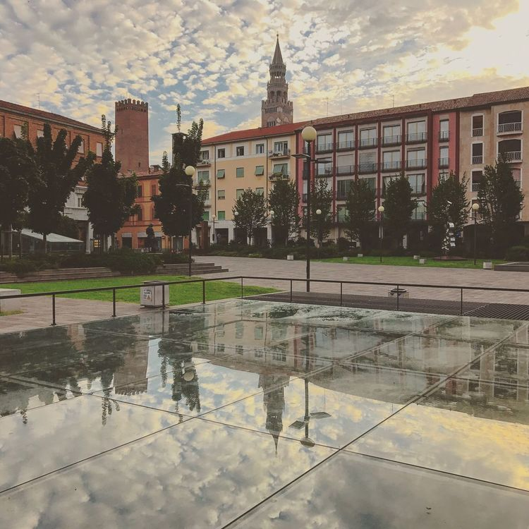 Architecture Built Structure Building Exterior Water Reflection Weather Sky Wet Puddle City Cloud - Sky Outdoors No People Reflecting Pool Day Tree Nature
