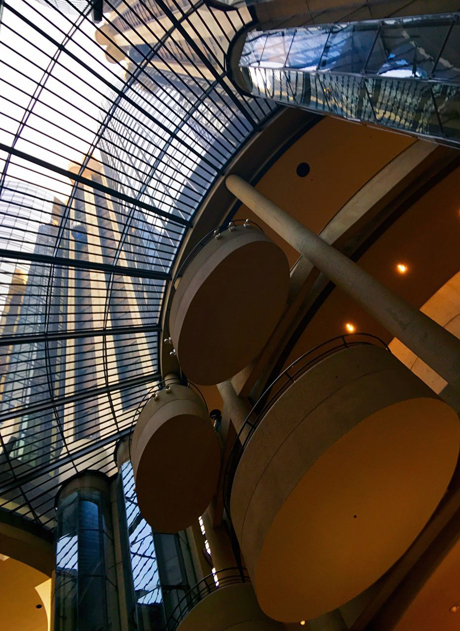 low angle view, architecture, built structure, indoors, ceiling, no people, day, modern, building exterior, illuminated