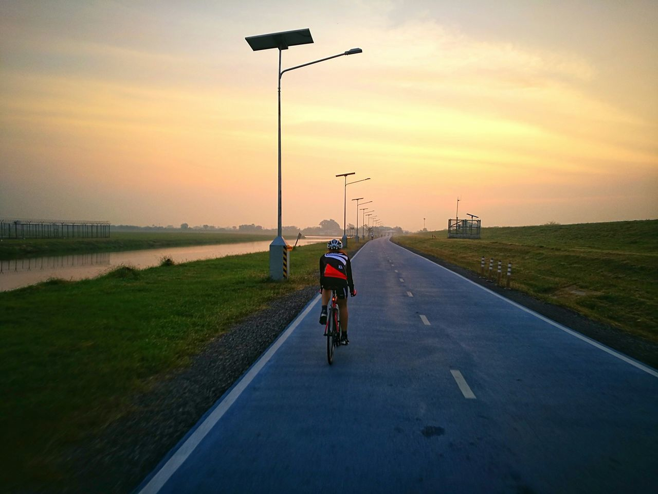 Sunset Bicycle Transportation People Street Light Outdoors Sky Day Nature