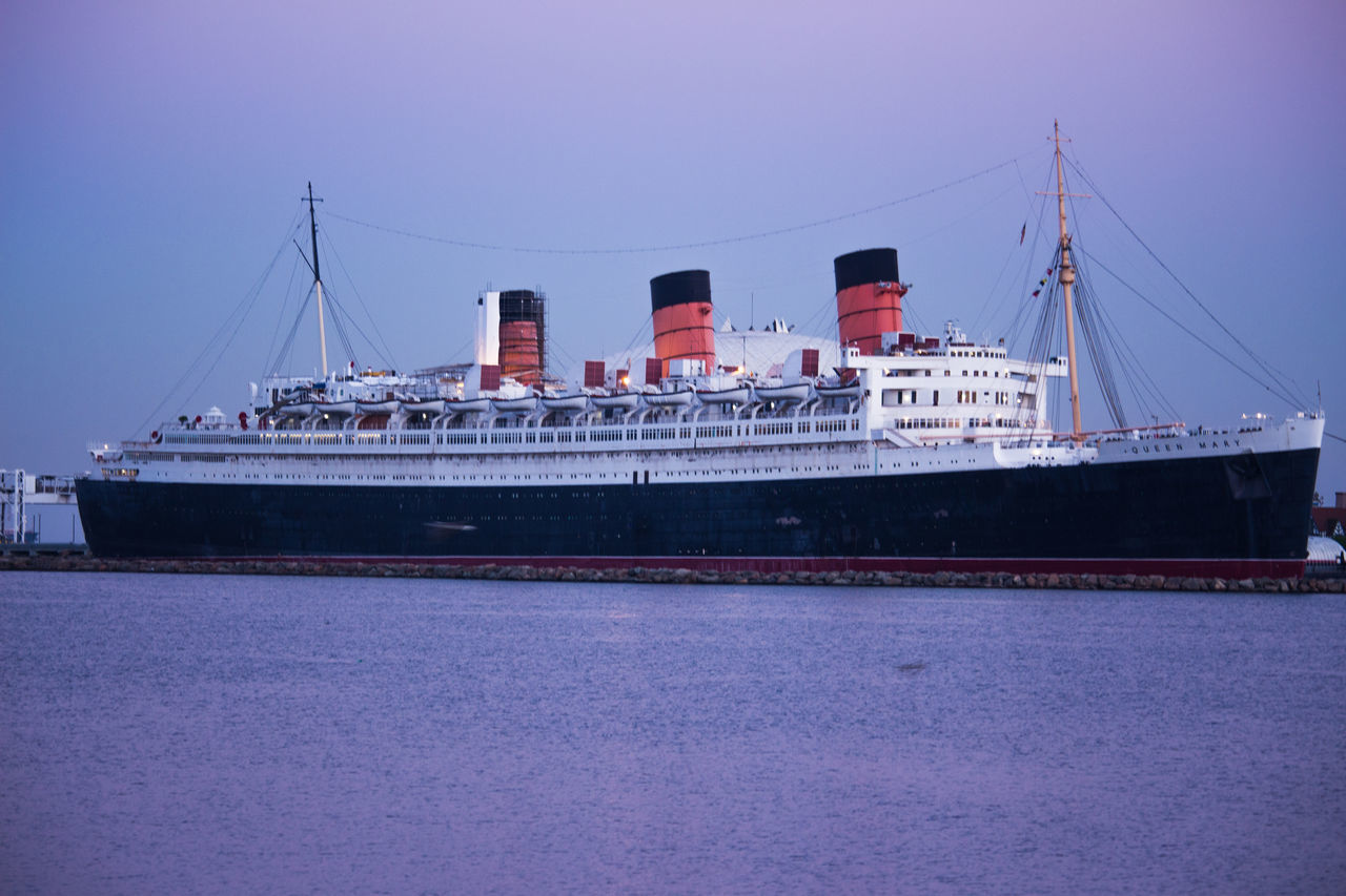 The Queen Mary built in United Kingdom in the 1930s and now rest here in Long Beach CA. nautical vessel transportation harbor sea outdoors ship commercial dock water no people day city sky shipyard Urban Skyline
