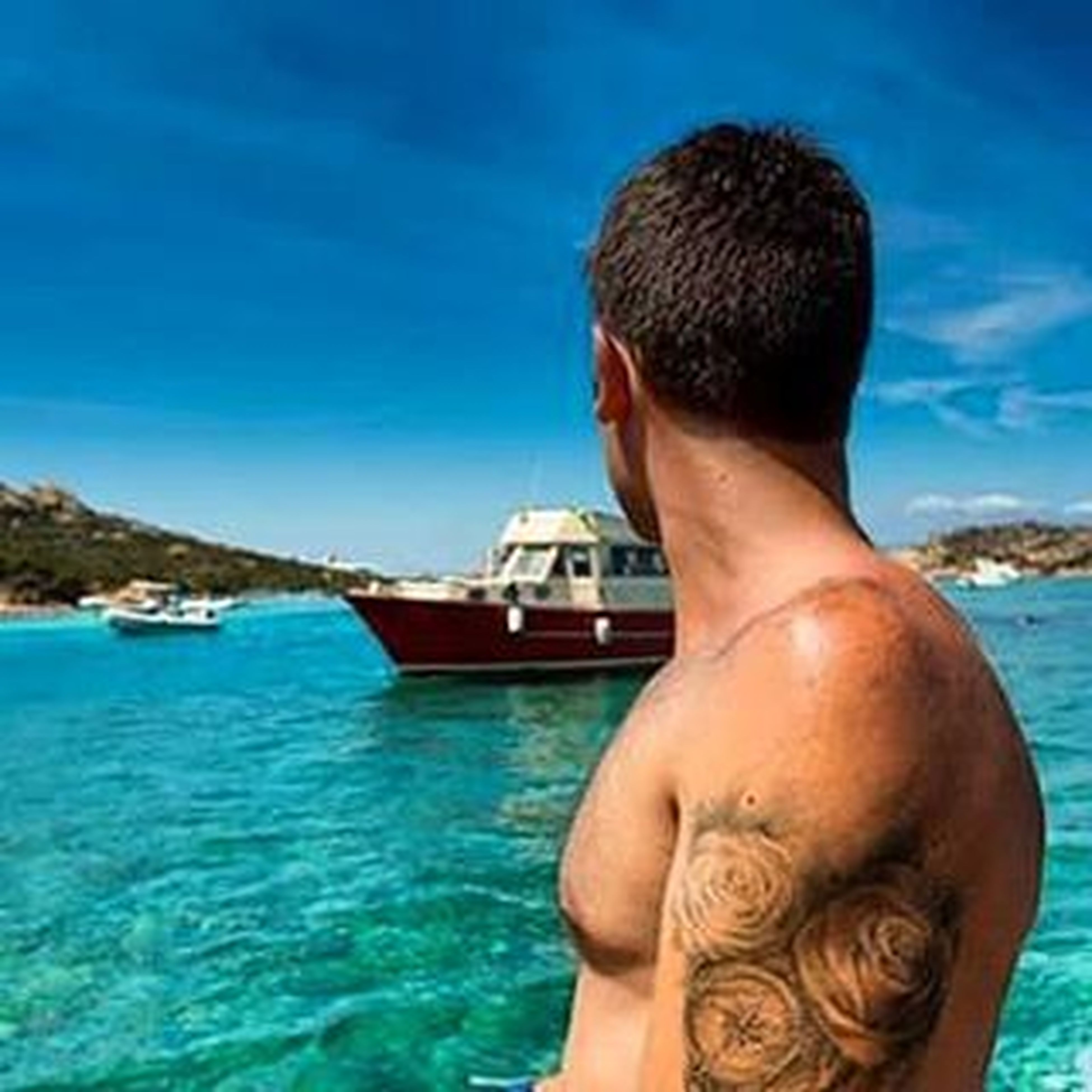 water, blue, lifestyles, sea, leisure activity, swimming pool, sky, waterfront, young adult, shirtless, sunlight, vacations, day, turquoise colored, outdoors, person, rippled, nautical vessel