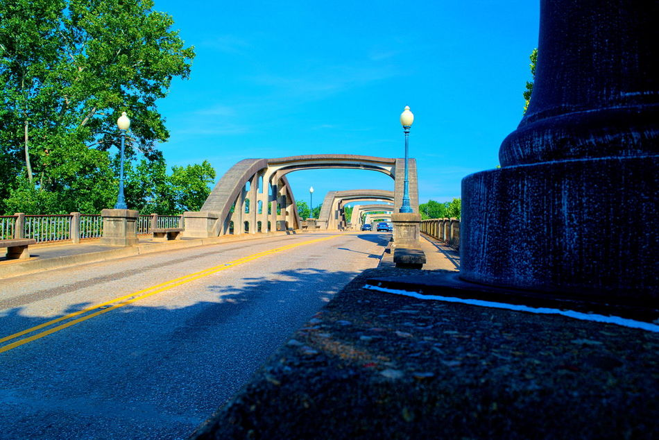 Coosa River Bridge in Wetumpka , Alabama Blue Bridge Bridge - Man Made Structure Country Road Day Diminishing Perspective Long Outdoors Sky Solitude Surface Level The Way Forward Tranquil Scene Transportation Tree