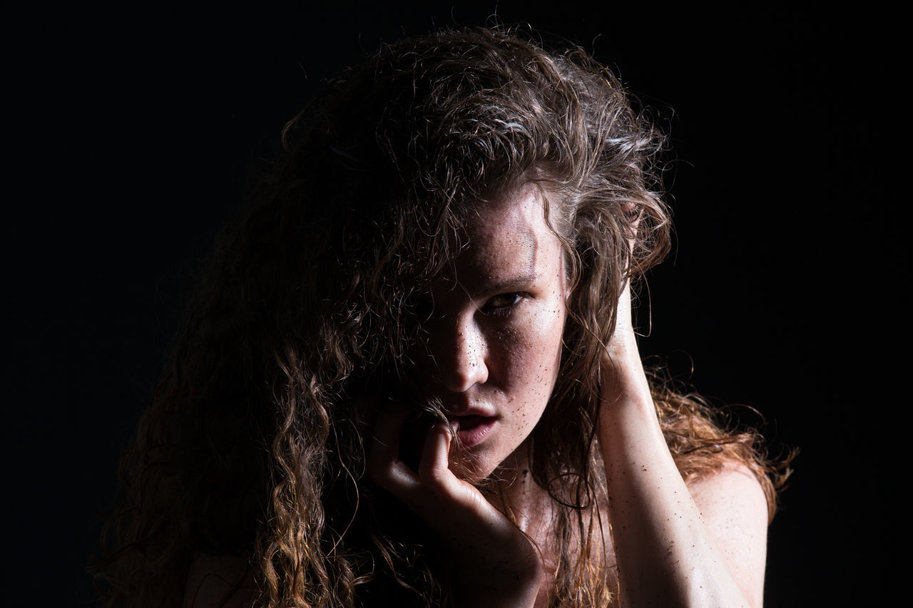 Adult Black Background Close-up Dark Dynamic Emotions Headshot Human Body Part Human Face Light And Shadow Light In The Darkness Long Hair One Person One Woman Only One Young Woman Only Only Women People Portrait Studio Shot Young Adult Young Women