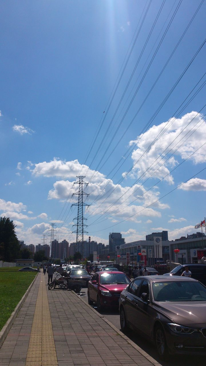 transportation, sky, land vehicle, car, mode of transport, cable, cloud - sky, day, no people, outdoors, road, built structure, electricity pylon, nature, architecture, city