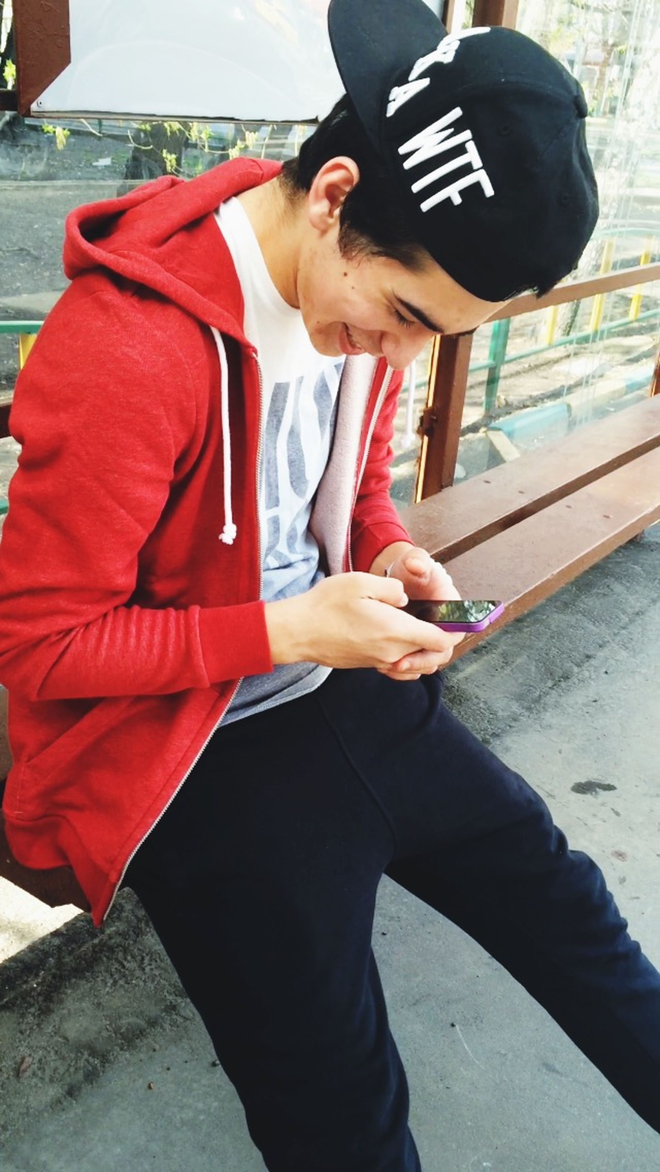 lifestyles, casual clothing, communication, holding, standing, leisure activity, young adult, technology, young men, wireless technology, three quarter length, mobile phone, front view, smart phone, photography themes, jacket, men, photographing