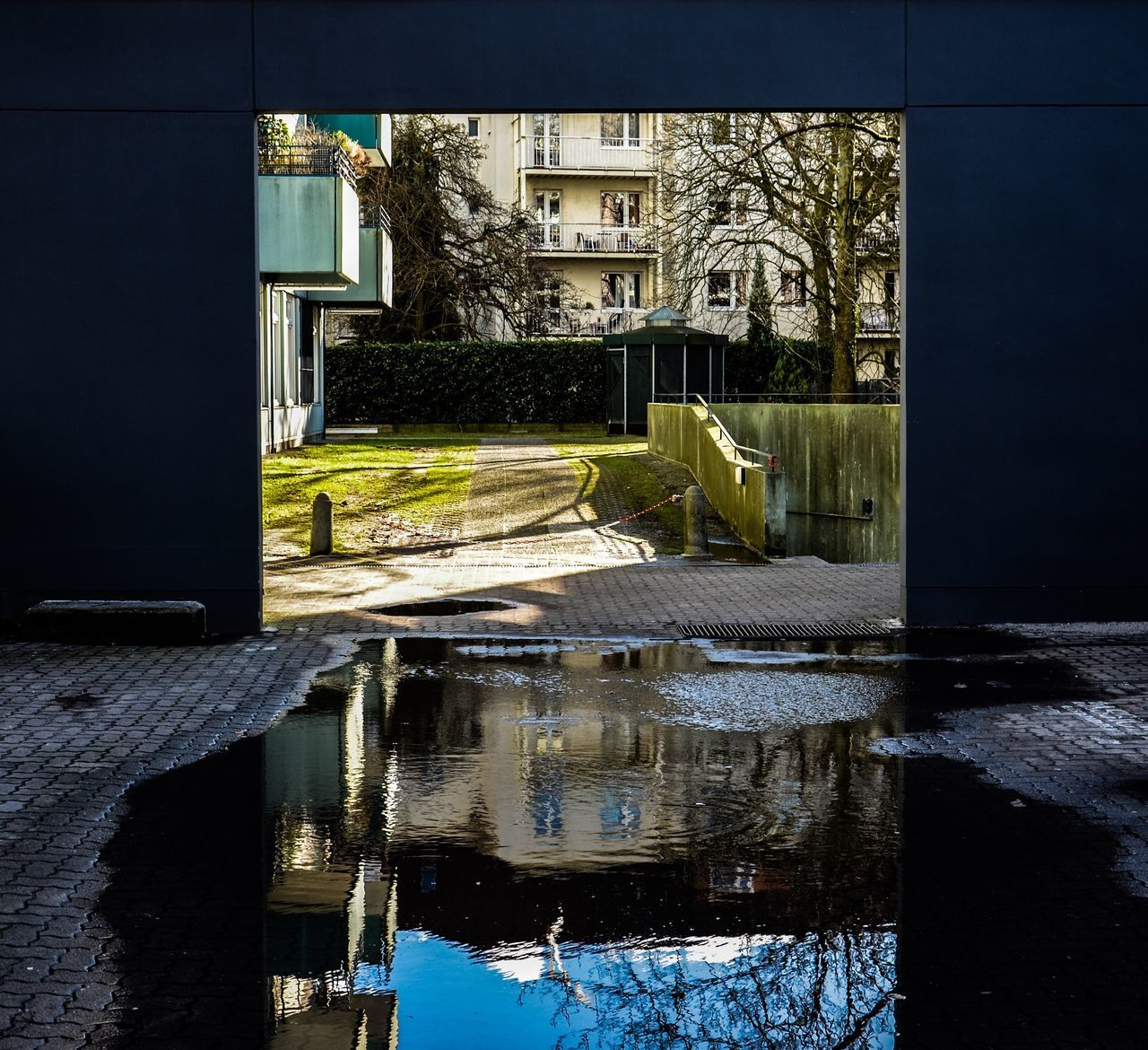 Behind The Wall Reflection Architecture Built Structure Water Building Exterior No People Tree Outdoors Nature Day Sky Puddle Reflection In Water Wall Behind The Wall Sunlight Green Light And Dark Go Through The Wall