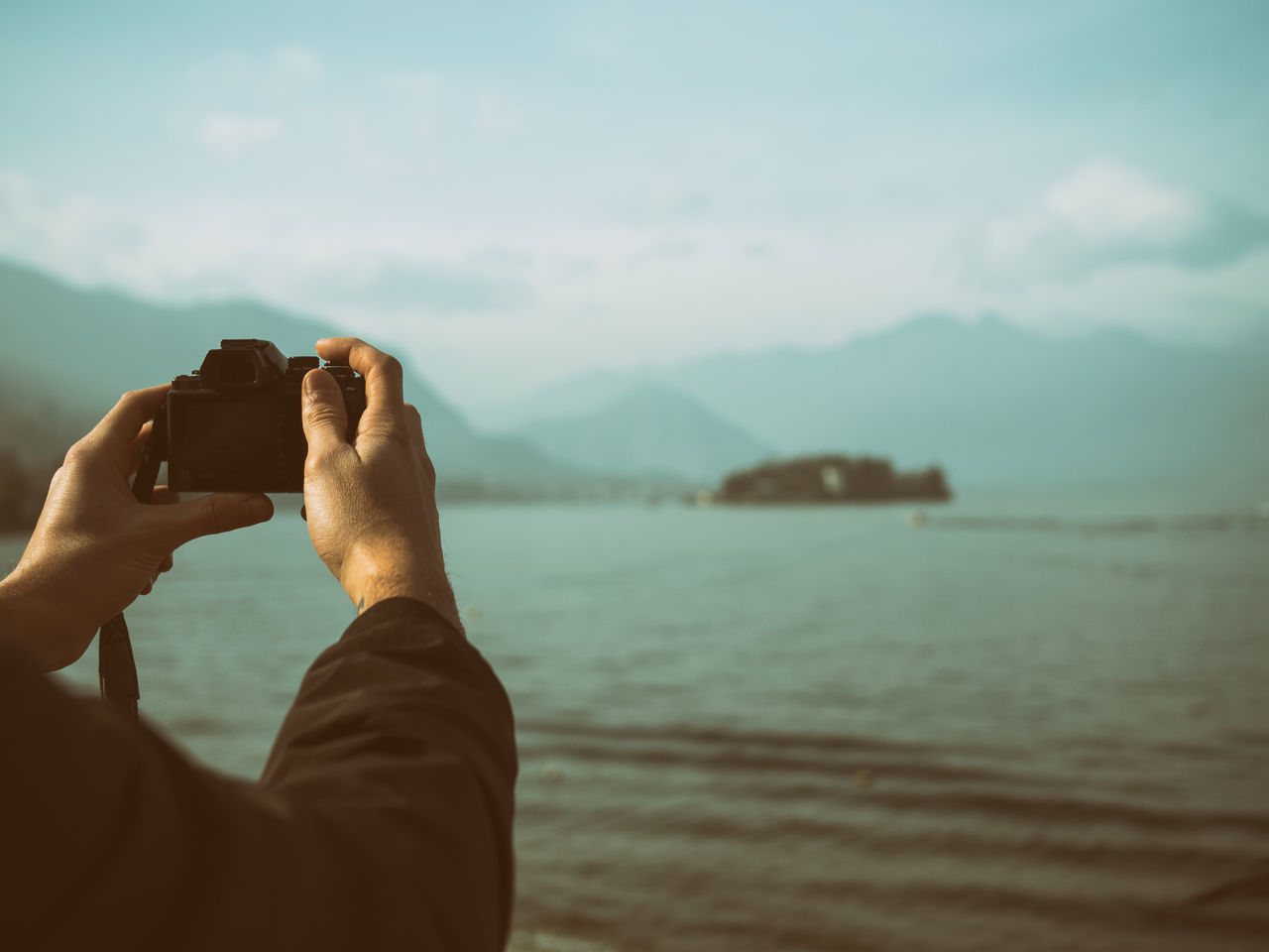Beauty In Nature Camera Camera - Photographic Equipment Hand Lake Landscape Light Light And Shadow Men Nature Nature Photography One Person Stresa Sunlight Sunrise Sunset Water Young Adult Young Men