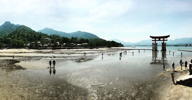 Beach Mountain Tranquil Scene Water Incidental People Scenics Sky Vacations Tranquility Shore Sea Tourism Tourist Person Calm Cloud - Sky Non-urban Scene Nature Mountain Range Beauty In Nature