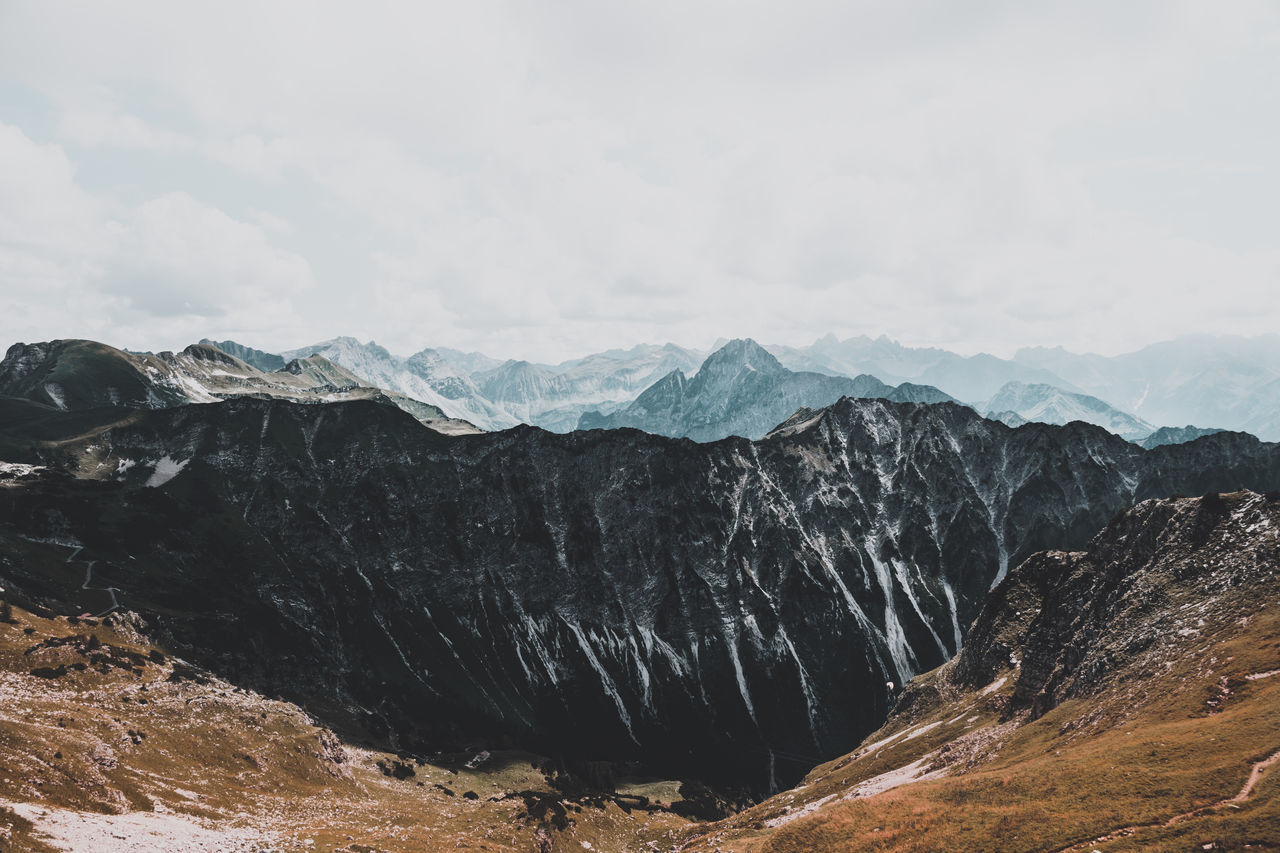 Mountain landscape in front of a cloudy sky Beauty In Nature Day Landscape Mountain Mountain Range Nature No People Outdoors Physical Geography Scenics Sky The Great Outdoors - 2017 EyeEm Awards