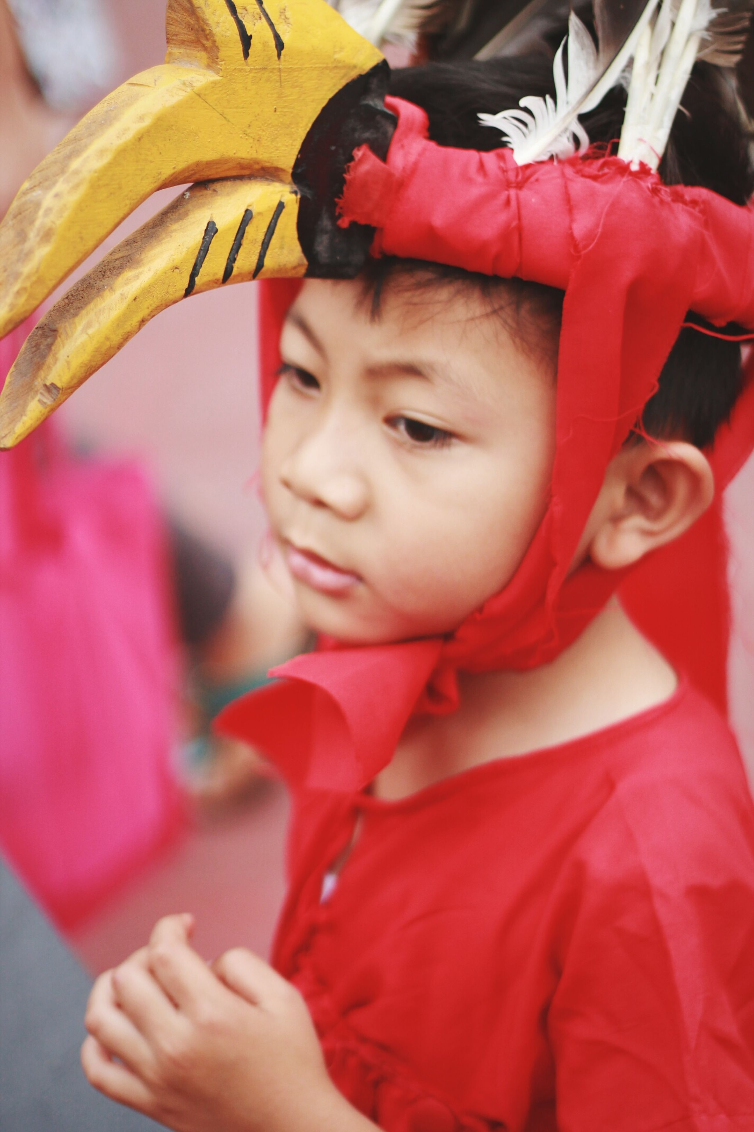 childhood, holding, elementary age, lifestyles, focus on foreground, leisure activity, girls, boys, innocence, cute, person, close-up, casual clothing, headshot, red, front view, incidental people