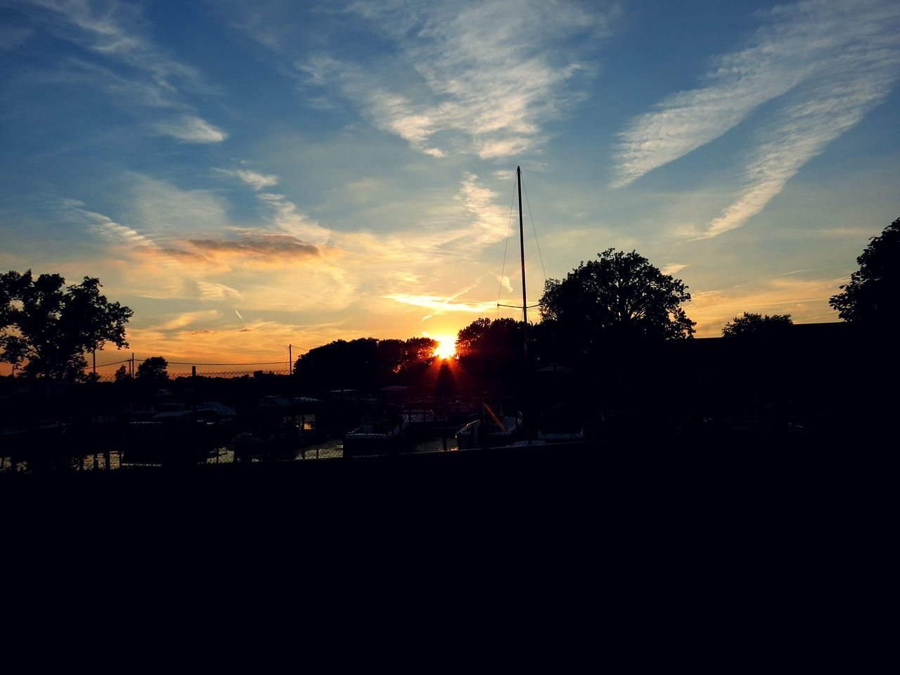 sunset, silhouette, sky, tree, cloud - sky, sunbeam, nature, sun, beauty in nature, no people, scenics, outdoors, tranquility, sunlight, landscape, architecture, day