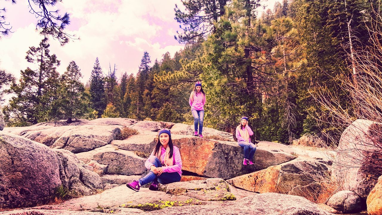 real people, leisure activity, rock - object, nature, lifestyles, tree, full length, outdoors, togetherness, casual clothing, beauty in nature, sitting, forest, day, girls, standing, scenics, sky, adventure, friendship, young adult, young women, people
