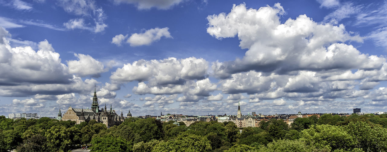 A panoramic view of Stockholm, the capital of Sweden and and the most populous city in the Nordic countries of Europe. Abundance of trees is a testament to the attention for the environment of this city and country in general. The large building on the left of the frame is the Nordic Museum, which opened in 1873 as the Scandinavian Ethnographic Collection (Skandinavisk-etnografiska samlingen). Nordic Museum Panorama Panoramic View Stockholm Sweden Travel Photography Treelined Architecture City Cityscape Cloud - Sky Day Green Color No People Panoramic Photography Travel Destinations Travelphotography Urban Skyline
