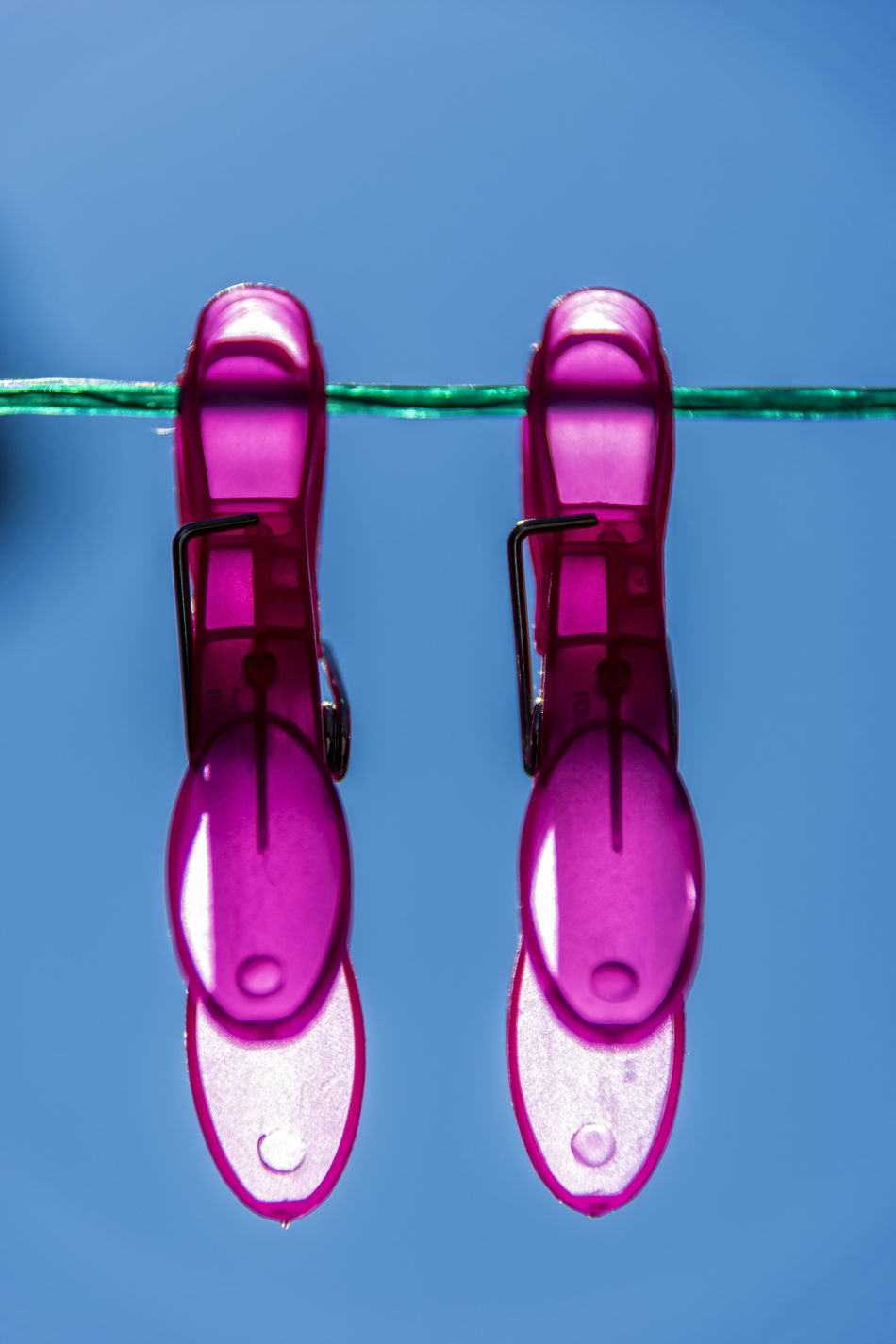 Magenta Blue Blue Background Blue Sky Close-up Clothes Pegs Clothesline Colored Background Day Green Line Laboratory No People Outdoor Pink Color Refraction
