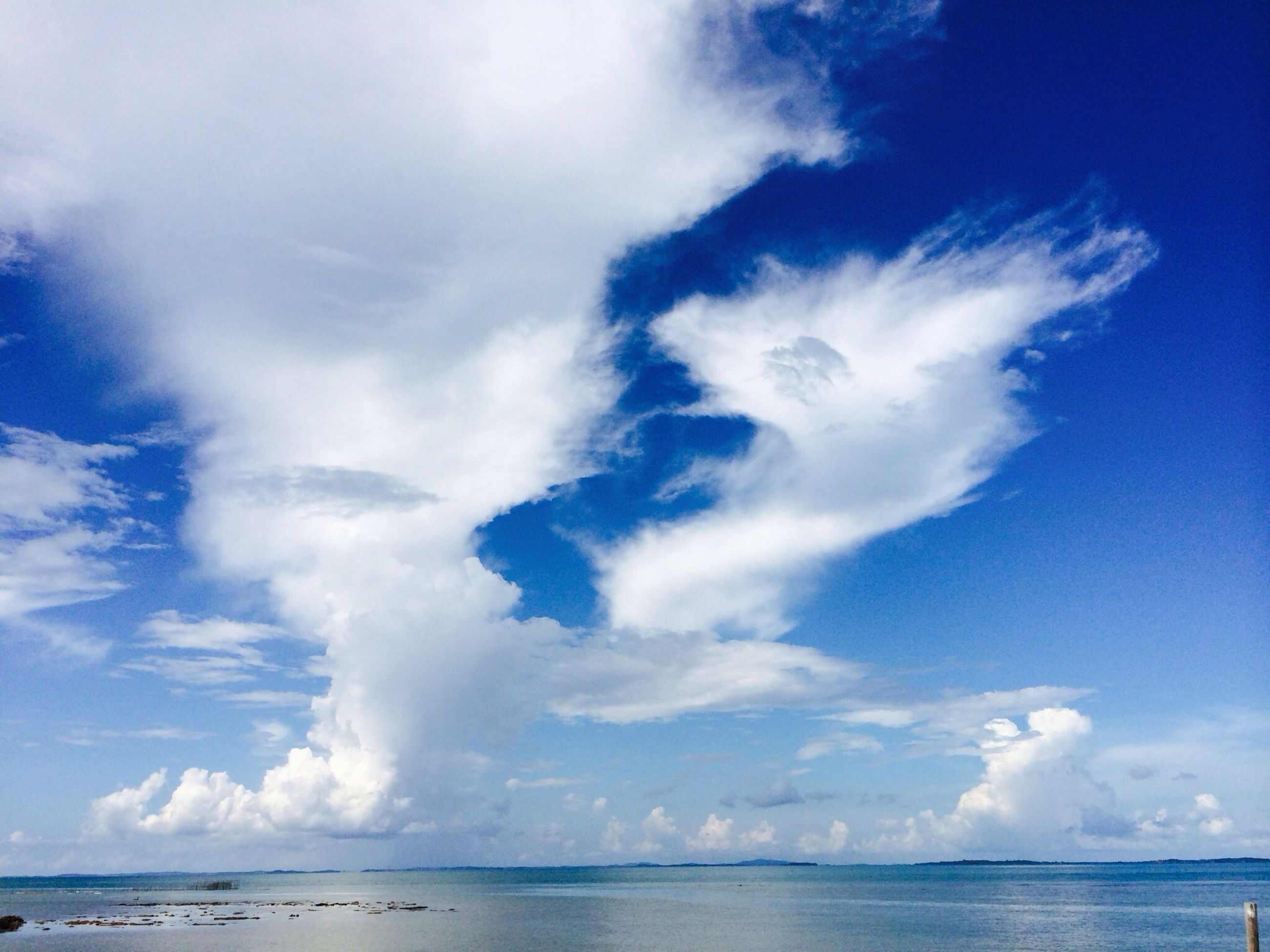 sea, sky, water, horizon over water, tranquil scene, tranquility, scenics, beauty in nature, blue, cloud - sky, nature, cloud, waterfront, cloudy, beach, idyllic, seascape, day, calm, shore