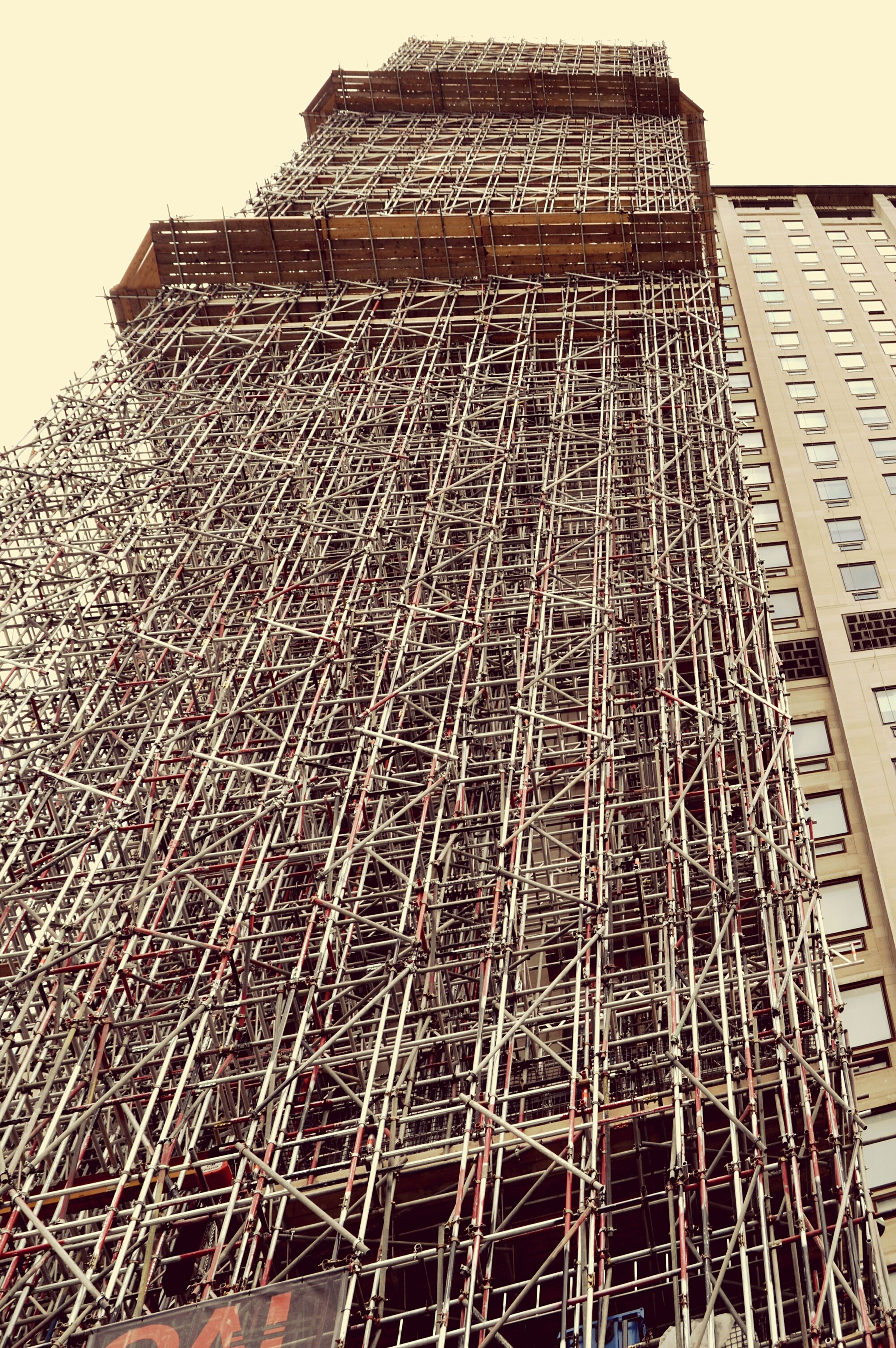 low angle view, architecture, built structure, building exterior, construction site, day, outdoors, no people, sky