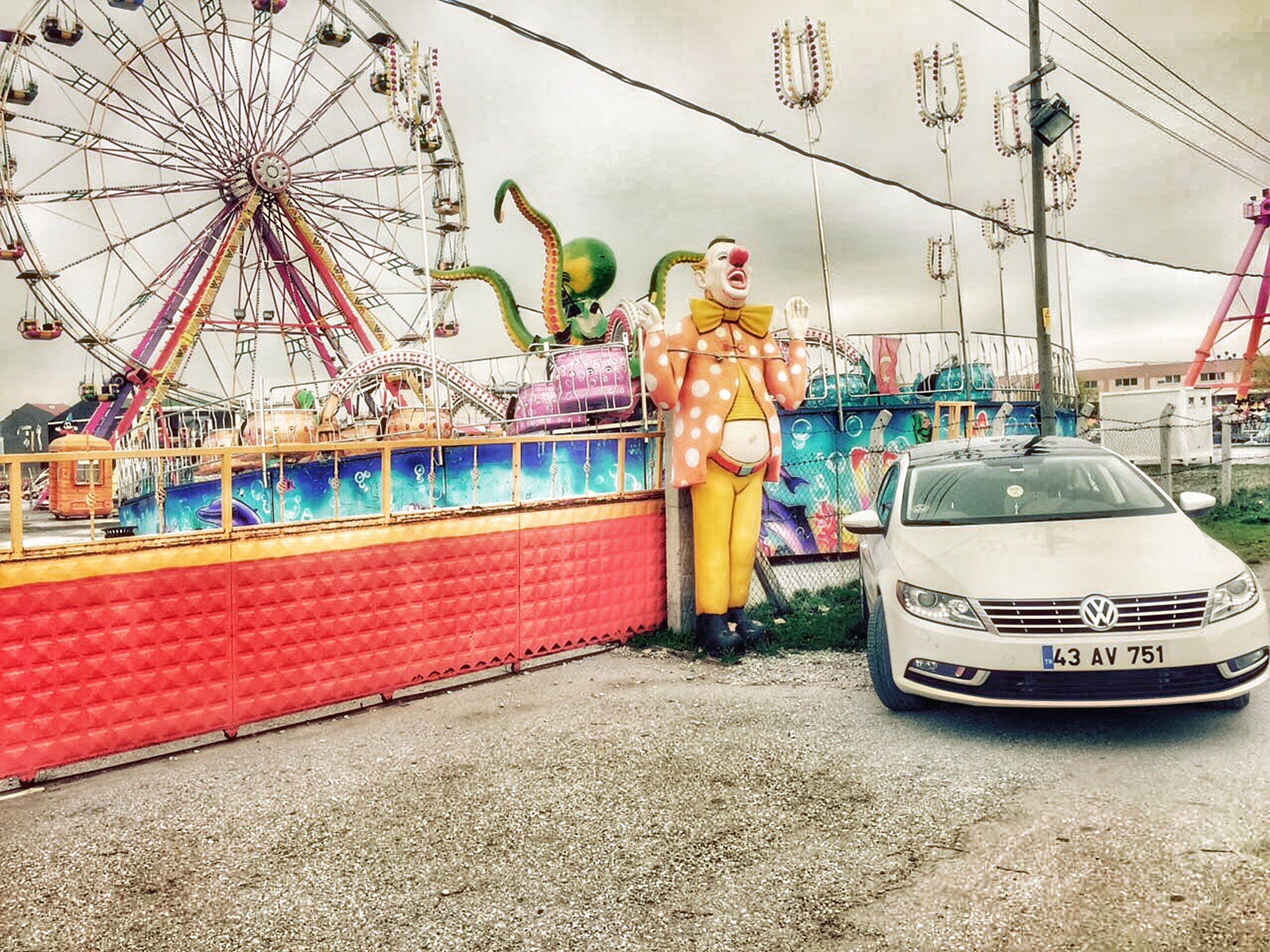 amusement park, amusement park ride, arts culture and entertainment, transportation, mode of transport, sky, architecture, built structure, art and craft, ferris wheel, art, land vehicle, incidental people, creativity, carousel, travel, building exterior, sculpture, animal representation, street