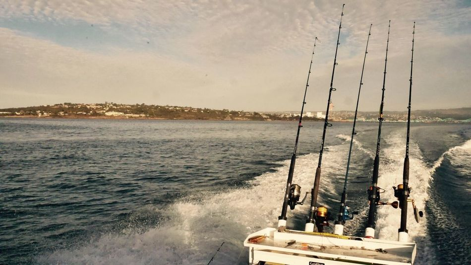 Leaving the land for a nice day fishing. Fishing Rods Fishingline Ocean Landscape Land Leaving Travel Boat Speed Sunny Clouds Bleu Sky Colors Vintage Photo Fish Friends Water Sea Nature Sky Outdoors Adventure Peace Outdoor Photography