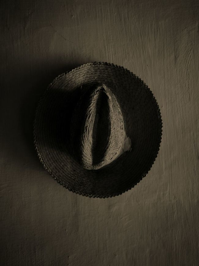"""Old hat wore by peasants in Romania hanging on a wall in the """"Village"""" Museum. Indoors  Close-up Creativity Hats Maramures County Blackandwhite Straws Rural Scene Agriculture"""