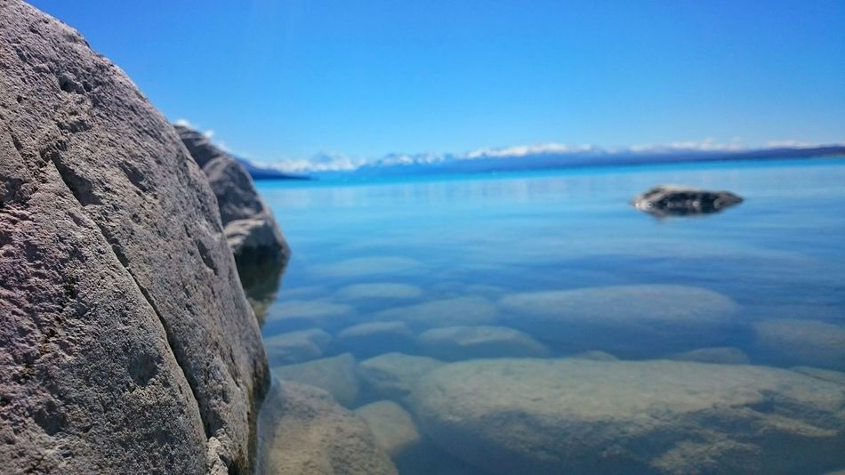 Glacier lake Pukaki, Tekapo, New Zealand Water Outdoors No People Beauty In Nature Scenics Nature Day Landscape Close-up Sky Glacier Lake Glacier Rocks Tranquil Scene Tranquility Glimmer Travel Volcanic Landscape New Zealand Scenery