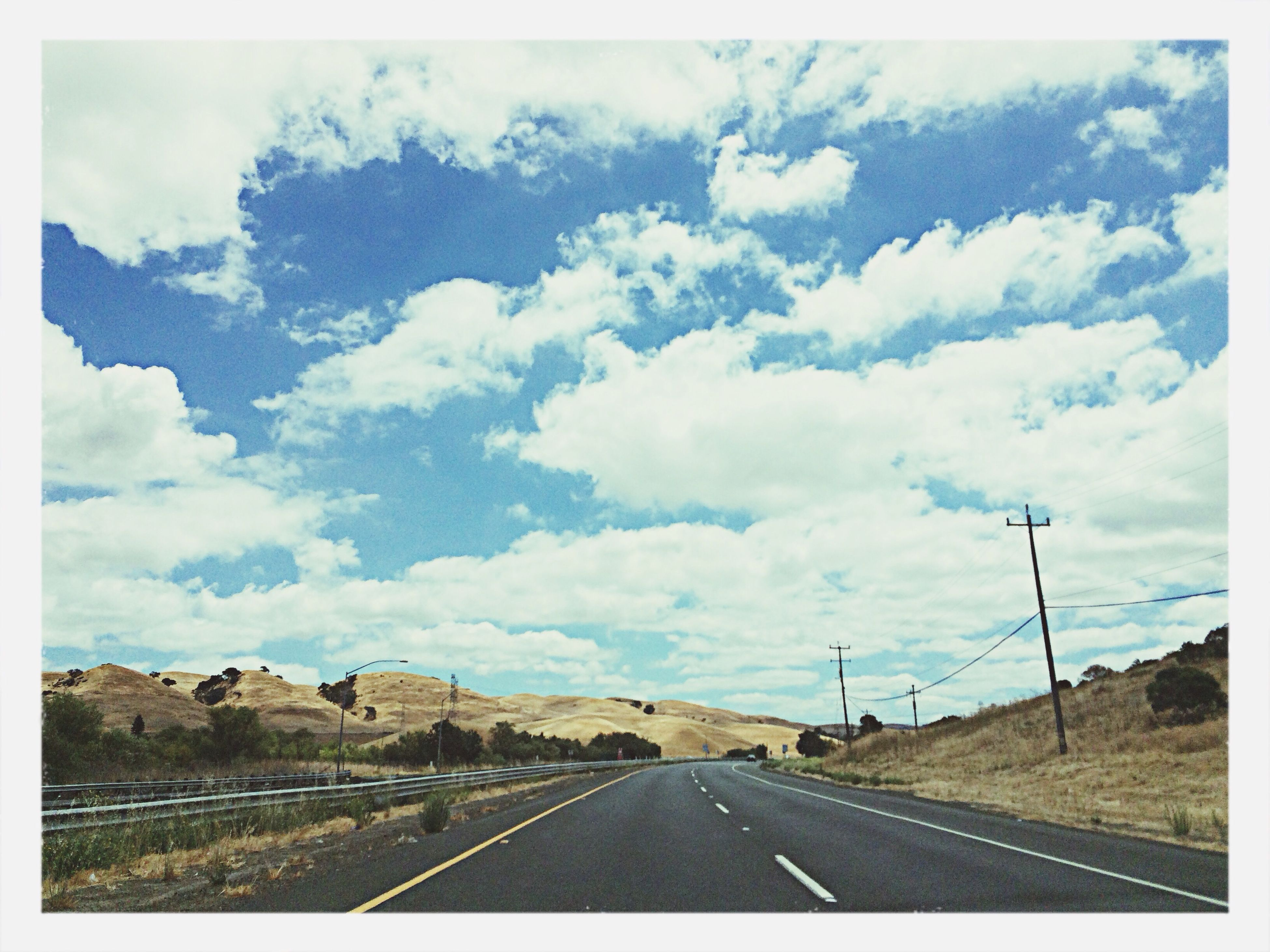 transportation, road, the way forward, sky, road marking, diminishing perspective, vanishing point, cloud - sky, transfer print, cloudy, cloud, country road, highway, landscape, auto post production filter, empty, street, empty road, car, asphalt