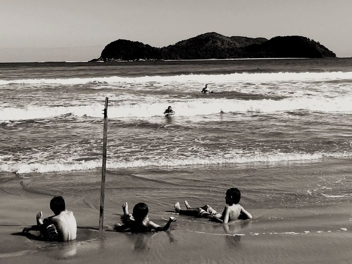 Kids playing at the beach 😆 Beach Sea Water Sand Real People Men Sitting Leisure Activity Lifestyles Nature Wave Day Scenics Beauty In Nature Horizon Over Water Outdoors Sky Kids Travel Destinations Blackandwhite Vacations Tranquil Scene Neighborhood Map People Live For The Story Live For The Story The Street Photographer - 2017 EyeEm Awards The Great Outdoors - 2017 EyeEm Awards Place Of Heart Black And White Friday